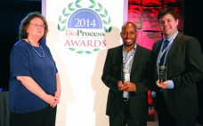 Mwai Ngibuini and Christopher Kistler accepting for TAP Biosystems (now part of Sartorius Stedim Biotech) and Merck