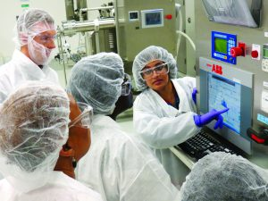 Photo 2: FDA students learn how to operate centrifuge controls for downstream operations.