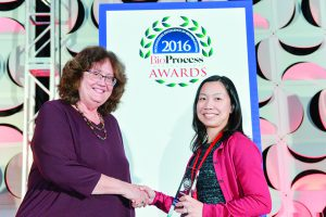 Cindy Jung accepts GlaxoSmithKline's Corporate Citizenship award from BPI's Anne Montgomery.